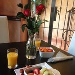 Delicious breakfast with fresh flowers