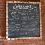 welcome chalk board with names of guests