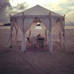 Our private cabana dinner facing beach and sunset <3