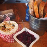 Melted Camembert with toasted pine nuts, rosemary, cranberry sauce and fresh breads