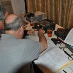 Two of our society members enjoying the repair of an amateur radio.