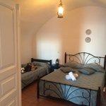 Bedroom.  2 more beds in living room area