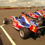 The formula cars depart for the track