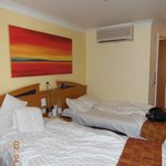 Twin beds with heater above