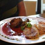Pork medallions with tomatoe ragu sauce and olives