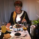 My partner enjoying the tastiest food in the dining room