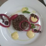 Venisson tartare w/ pickled red onions and egg yolk dressing