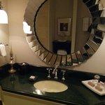 marbled sink & large mirror in bathroom