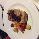 Pork tenderloin with mashed potato, honey roasted vegetables, parsnip mousse and chasseur sauce