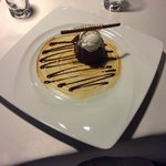 Chocolate fondant whiskey flavoured filled with hot chocolate, served with coconut ice creams an