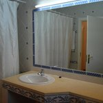 Bathroom with lovely tiles. Bath with shower
