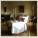 the chicest breakfast or reception room looking onto the grounds and river