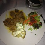 Duck in orange suace with baked potato and salad. Delicious