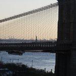 Statue of Liberty as seen from Manhattan bridge at dusk