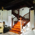 The beautiful staircase to the first floor where there are three rooms plus a family suite on th