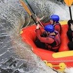 Surfing the waves at the white water rafting centre.