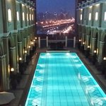 Beautiful swimming pool with Dubai sky in the background