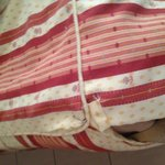 Bedclothes pinned together