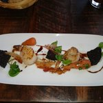 Starter of perfectly cooked scallops, black pudding and celeriac dressing.