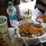 Mojitos, lionfish empanadillas, mahi skewers, seafood nachos
