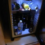 Bar fridge with ALOT of beer bottles
