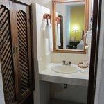 Another closet near bathroom sink