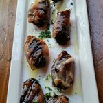 Smoked ham wrapped prunes stuffed with Mahon cheese