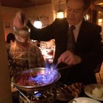 Chef/Owner Lino preparing our delicious Cherries Flambe