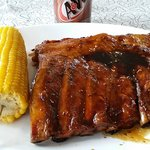 Half a rack of ribs and corn on the cob