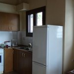Kitchen with full cooker and fridge/freezer