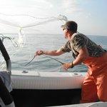Daniel casting the net for bait.