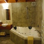 Spa bath and shower in Beachfront Cottage