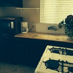 Kitchenette with board over sing