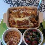 Delicious special: Chicken enchiladas, Mexican rice, and black bean salad
