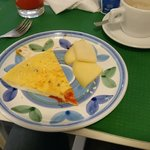 Part of our breakfast - freshly baked omlette and typical sicilian cheese