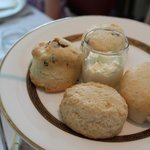 Plain and raisin-studded scones with a pot of devonshire cream