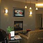 TV & 2 sided fireplace in dining area