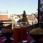 An aperitive on the balcony looking the Vatican Museum on the horizon
