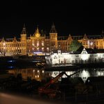 Centraal station and canal in the night