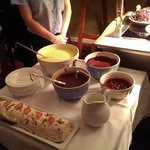 Passion Fruit Roulade and Custard, Chocolate, Rasberry Sauces etc.