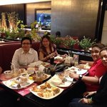 Enjoying the food with my friends.