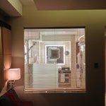 Big window between room and bathroom.