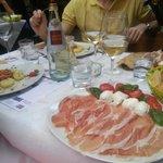 Buffalo mozzarella with prosciutto, salad with fish