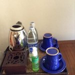 tea set, complementary water, and mosquito repellent spray