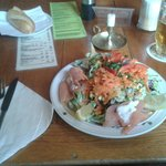 a salad with smoked salmon and a baguette