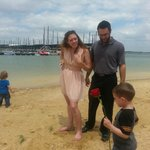 My daughter, son-in-law & grandsons walking on Sneaky Pete's beach after brunch