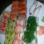 An appetizer, 6 deluxe Sushi Rolls and 2 Taco, with drinks $80