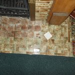 President Reagan would hide change under this loose tile.