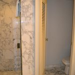 shower stall with toilet room beside