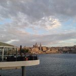 Dramatic view of the sea front bar looking across to Valetta